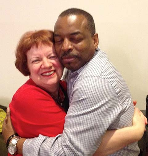 Mary Hoffman gets a hug from LeVar Burton, who wrote an Afterword for the 25th Anniversary edition of her picture book Amazing Grace
