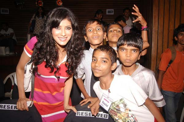 Nandana Dev Sen with boys at a theatre workshop for children with special educational needs