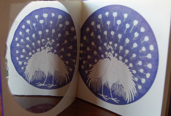 An example of a reflected illustration from Demi's Reflective Fables (showing the fable 'Two Peacocks')