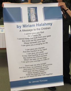 Miriam Halahmy presented with a poster of her poem dedicated to Janusz Korczak by Helen Bonney at the UK SCBWI Conference 2011.